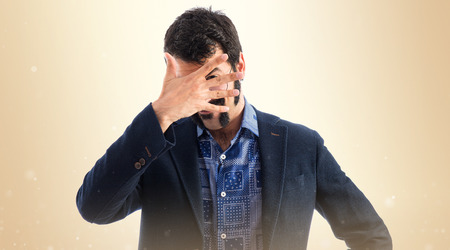 gesticulate: Vintage young man covering his face Stock Photo