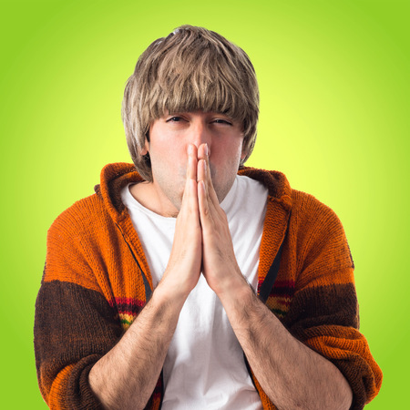 plead: Blonde man pleading over white background Stock Photo