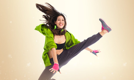street dance: Teenager girl jumping in street dance style Stock Photo