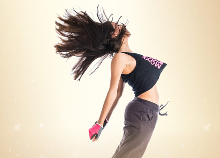 hip hop style: Teenager girl jumping in hip hop style Stock Photo