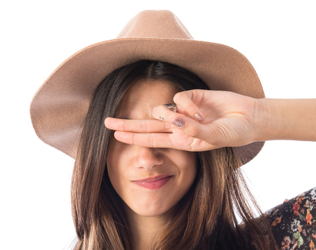 covering: Woman covering her eyes