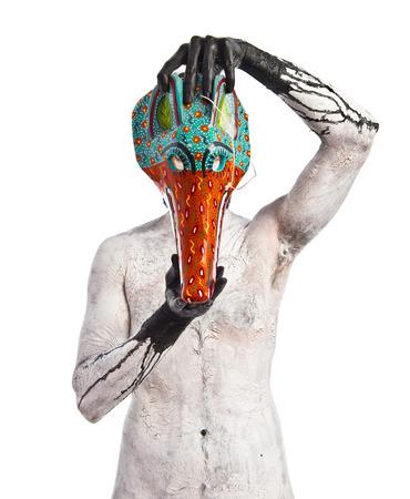 satanism: primitive man with fox mask