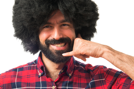 funny guys: Afro man making phone gesture Stock Photo