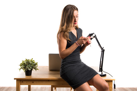 working woman: Woman working in her office Stock Photo