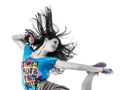 Teenager girl jumping in street dance style Stock Photo