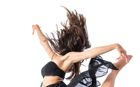 dance drama: Young ballet dancer jumping over white background