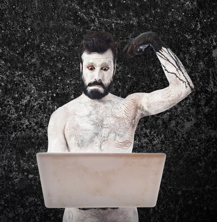 satanism: Painted man with laptop