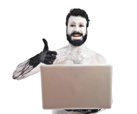 prehistoric man: Prehistoric man with laptop