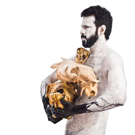 prehistoric man: prehistoric man holding animal skulls