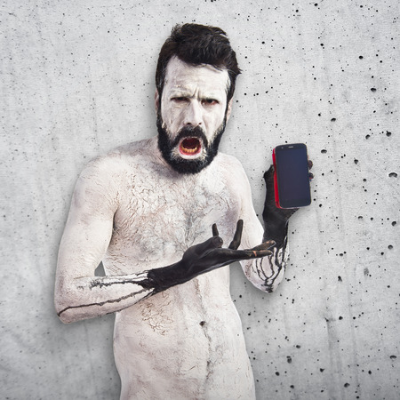 satanism: Monster holding phone