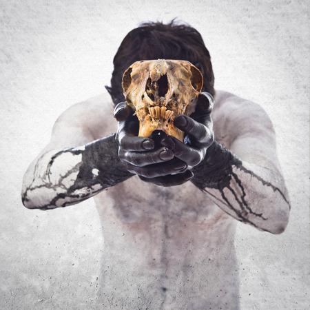Primitive man offering a rabbit skull
