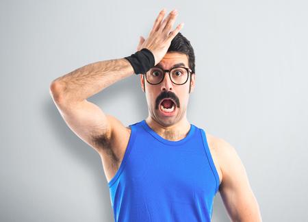 surprise: Crazy sportman doing surprise gesture Stock Photo