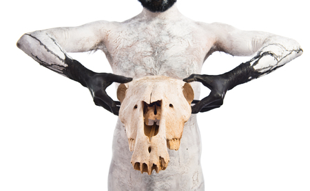 death head holding: Primitive man holding horse skull