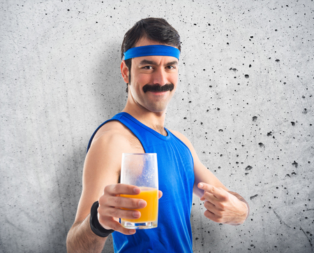sportman: Vintage sportman with orange juice