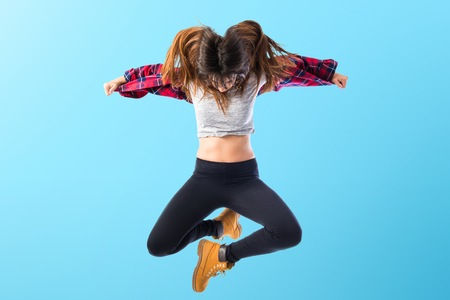 grunge teenager: Girl jumping in hip hop style