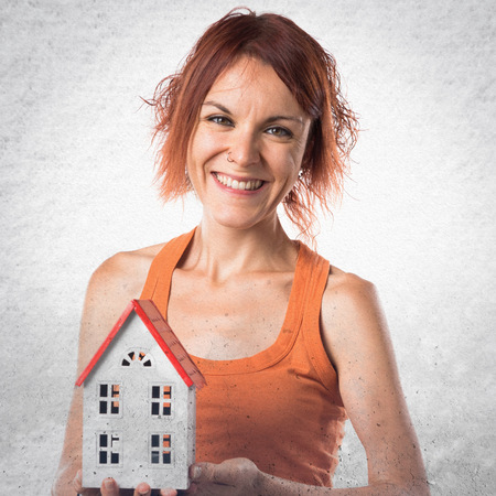 icone: Woman holding a little house Stock Photo