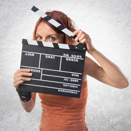 clapperboard: Woman holding a clapperboard