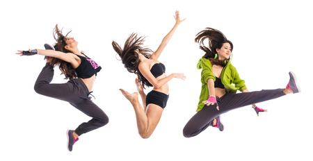 Teenager girl jumping in hip hop style Foto de archivo