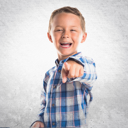 kid pointing: Kid pointing to the front Stock Photo