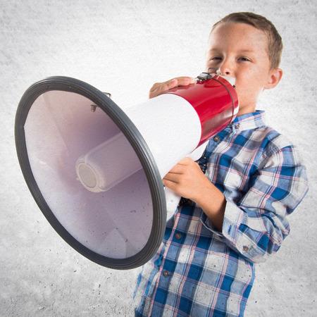 blonde hispanic: Kid shouting by megaphone