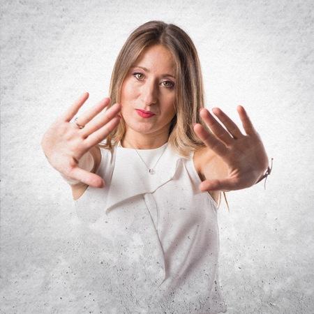 stop gesture: Woman making stop gesture Stock Photo