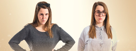 well dressed girl: Sad twin sisters Stock Photo