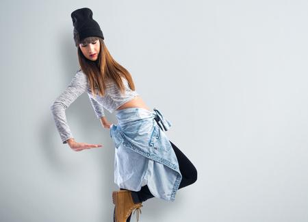 hop: Dancer posing over white background