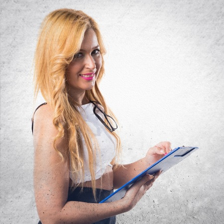 holding notes: Business woman holding notes