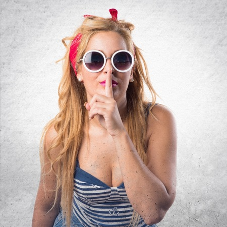 silence gesture: Pin-up girl making silence gesture