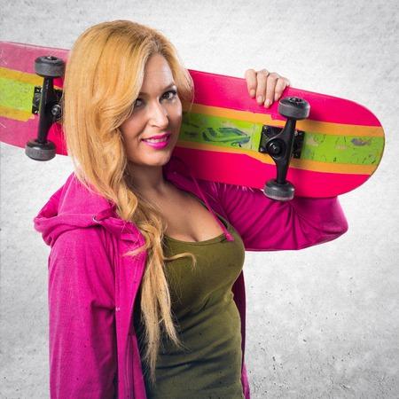 sweatshirt: Skateboarder girl with pink sweatshirt