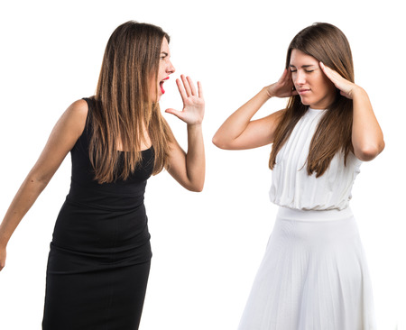 woman shouting: Woman shouting at her sister Stock Photo