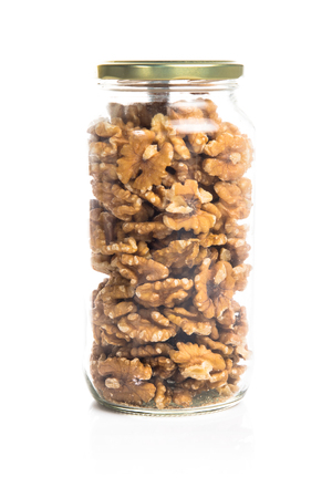 shelled: Shelled walnuts inside jar glass