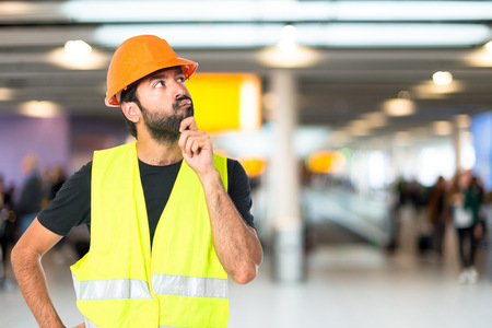 worker construction: Workman thinking over isolated white background Stock Photo