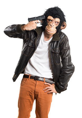 holding gun to head: Monkey man cometing suicide Stock Photo
