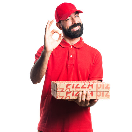 ok sign: Pizza delivery man making OK sign
