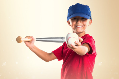 Blonde kid playing baseball