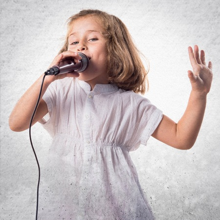 cute little girl: Girl singing with microphone Stock Photo