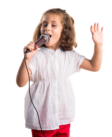 Girl singing with microphone 版權商用圖片