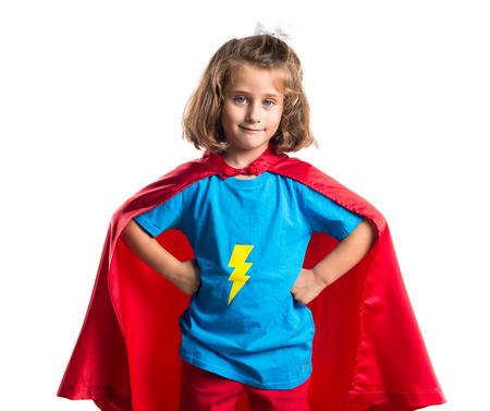 little girl posing: Kid dressed like superhero