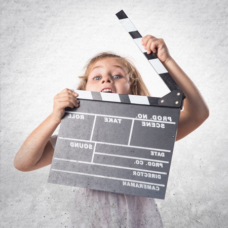 clapperboard: Girl holding a clapperboard