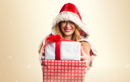anniversary sexy: Christmas woman holding a gift Stock Photo