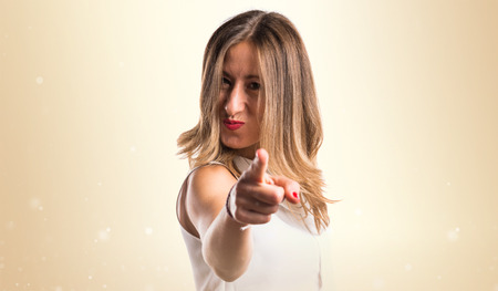 blonde hispanic: Woman pointing to the front Stock Photo