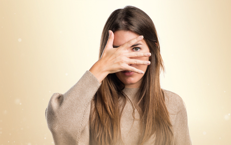 covering: Girl covering her face