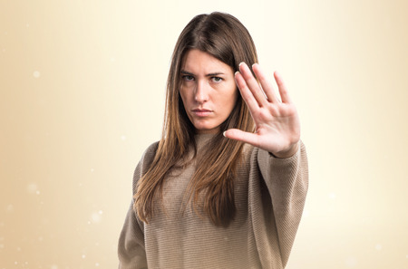 Girl making stop sign