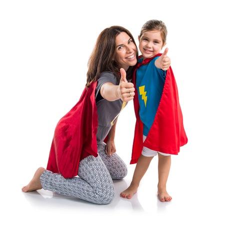 Family dressed like superhero with thumb up