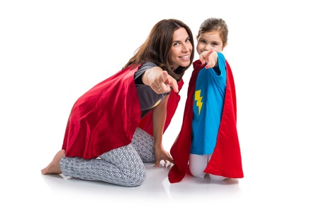 kid pointing: Family dressed like superhero pointing to the front Stock Photo