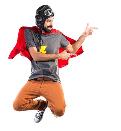 Superhero pointant vers le latéral Banque d'images - 48987670
