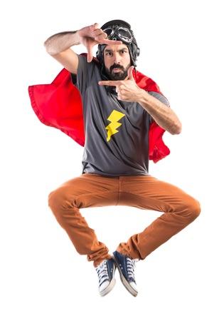 powerful creativity: Superhero focusing with her fingers Stock Photo