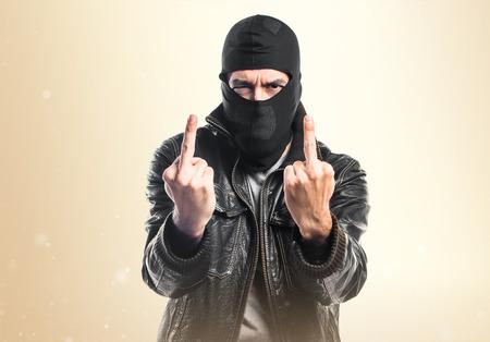 Robber making horn gesture