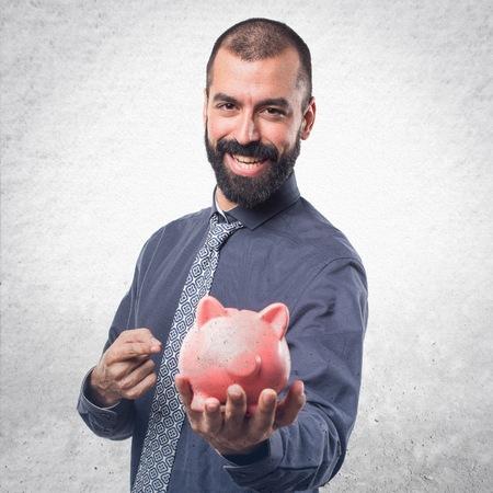 Man holding a piggybank Stock Photo